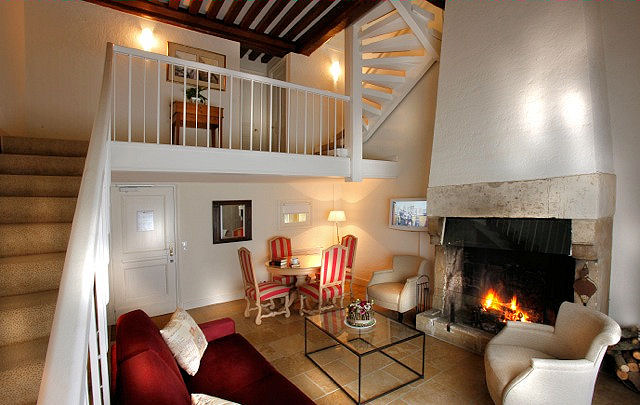 A warm and inviting ambiance fills this cozy triplex, one of six styles of accommodations. Photo: Courtesy of Les Manoirs de Tourgéville.