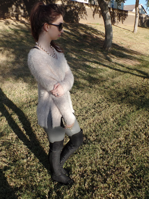 fuzzy oversize sweater and over the knee boots