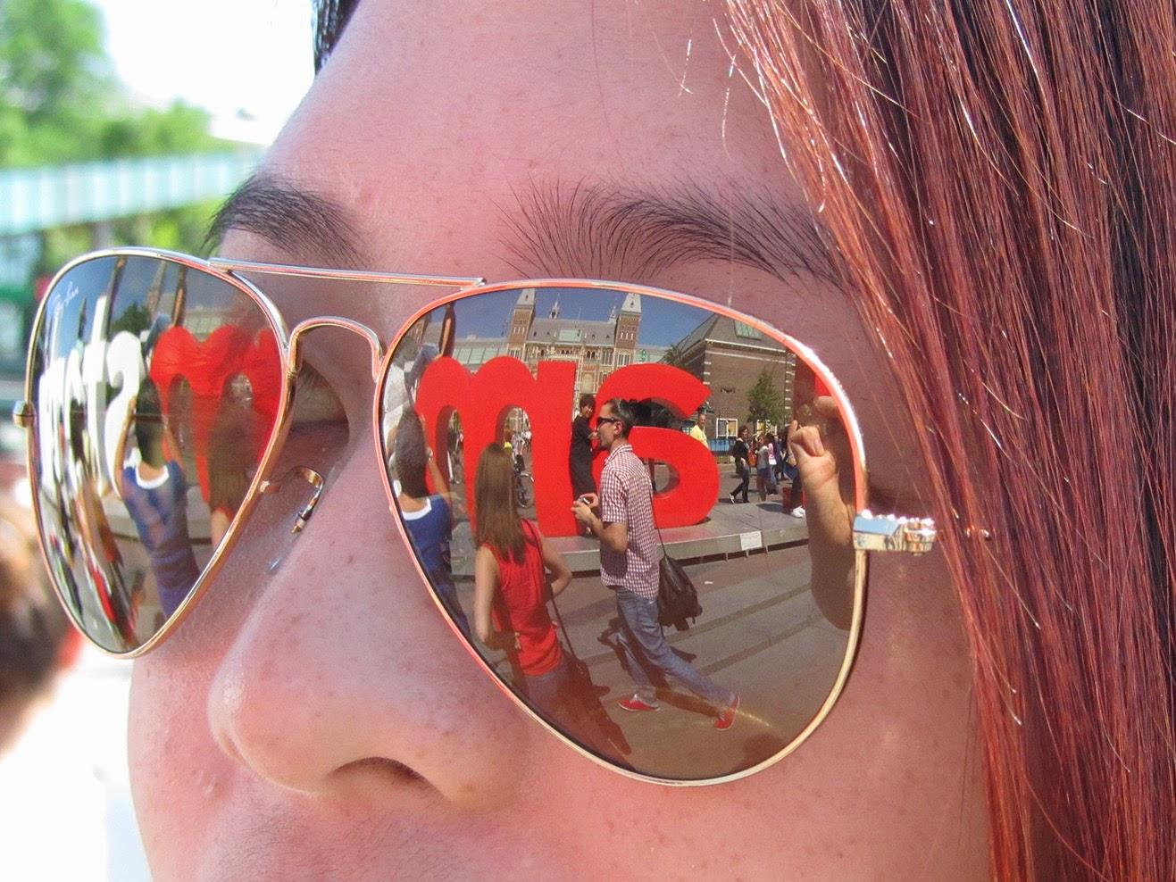 Girl with Iamsterdam reflected