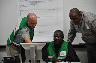 Correctional leaders from across the country confer during a simulation involving Texas prison during a hurricane.