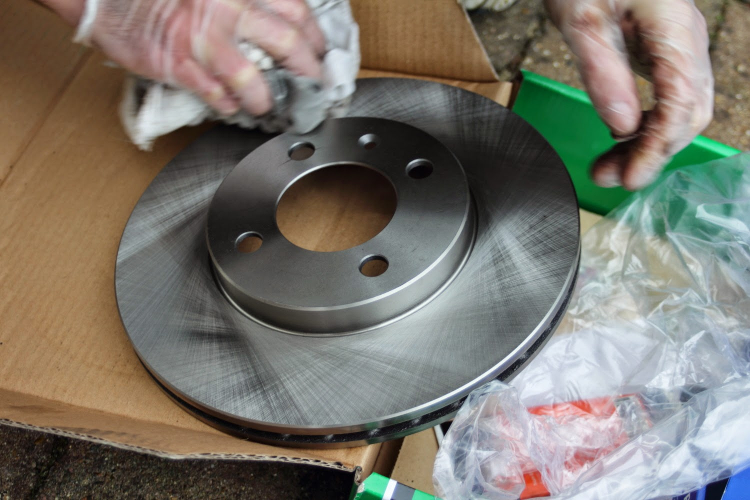 Cleaning new brake discs before fitting to the Golf GTI