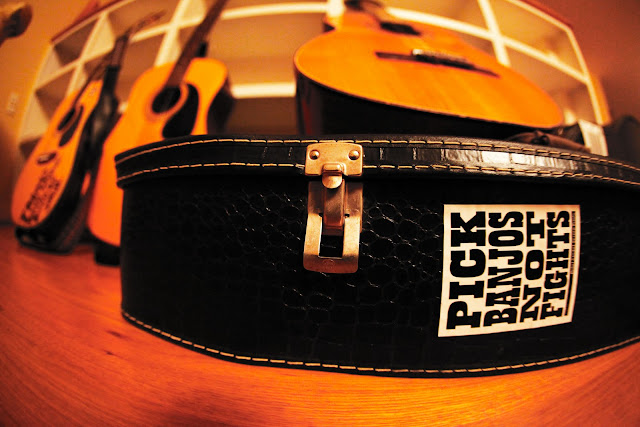 "A sticker on a guitar case that says ""Pick Banjos Not Fights""."