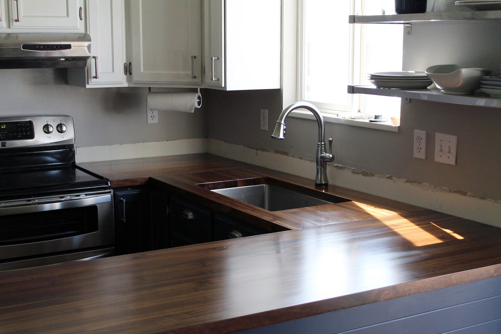 Wooden island countertop and bleach for Bleaching kitchen cabinets