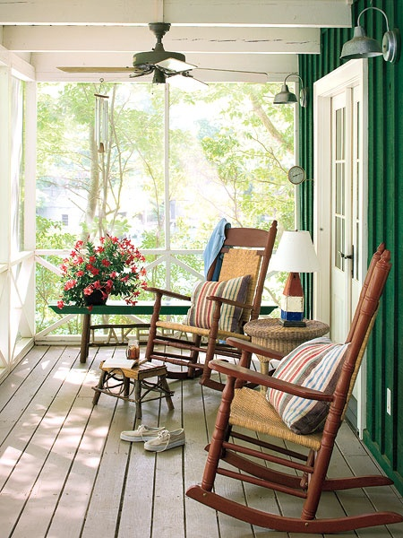 Love this country style front porch decor. Cushioned rockers with colorful striped pillows look great on this porch