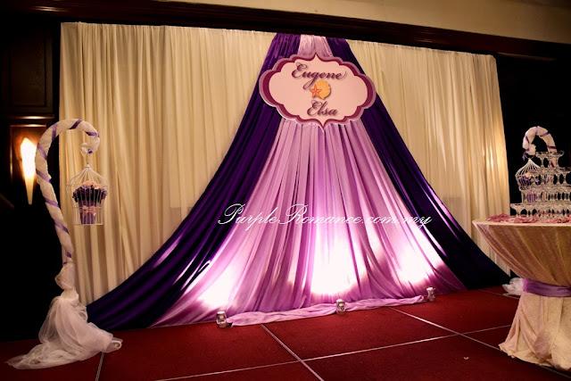 stage decoration, backdrop decoration, logo, wedding event, planning, planner, ballroom, hotel, the saujana hotel, kuala lumpur, selangor, malaysia, spotlights, zamrud ballroom, draping, purple theme, bird cages,