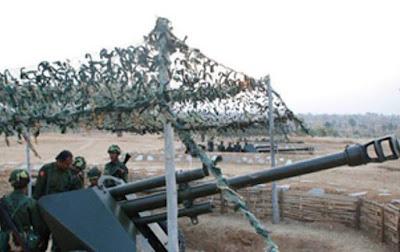 လက္နက္ႀကီးအေျမွာက္နဲ႔အတူ အစိုးရစစ္သားမ်ားကို ေတြ႕ရစဥ္ Photo: Kachin Land