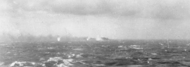 Battle of Atlantic - The Final Battle  27 May 1941 Surrounded by shell splashes, Bismarck burns on the horizon.
