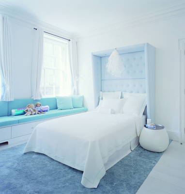 light blue bedroom inspiration with dramatic headboard. i mean seriously how tall is that headboard??