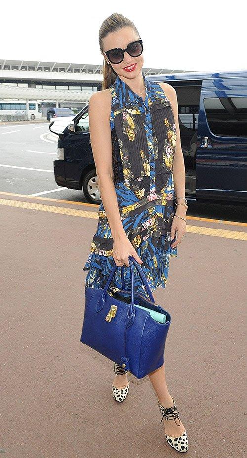 Miranda Kerr wears leopard print heels with a glossy red lipstick