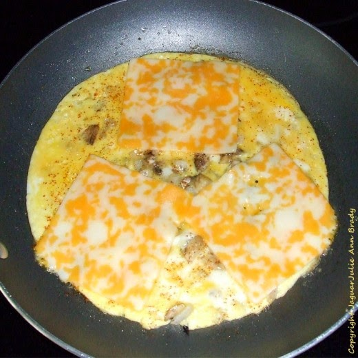 step one Easy Cheesy Omelet with Mushrooms and Onions