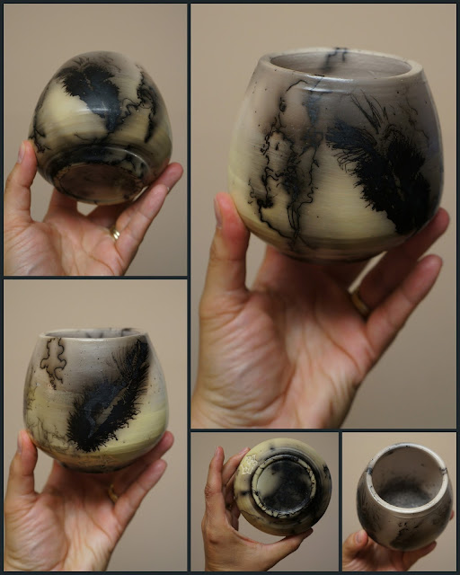 Unique beautiful handthrown horsehair raku pottery vase with feather imprints.