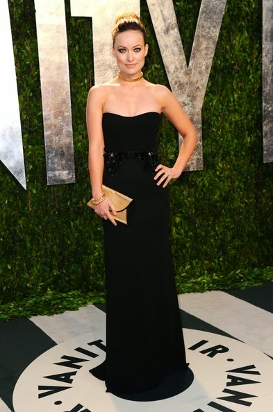The `Cowboys & Aliens` star Olivia Wilde looked gorgeous in a black strapless silk georgette evening gown during the 2012 Vanity Fair Oscar Party hosted by Graydon Carter at Sunset Tower on February 26, 2012 in West Hollywood, California.