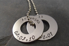 Personalized handstamped necklace featuring children&#39;s names and date of bith. 