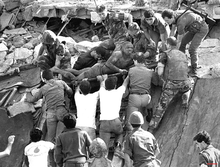 36 Amazing Historical Pictures. #9 Is Unbelievable - Oct.23,1983,a suicide truck-bombing at Beirut International Airport in Lebanon killed 241 U.S. Marines and sailors;a near-simultaneous attack on French forces killed 58 paratroopers.British soldiers give a