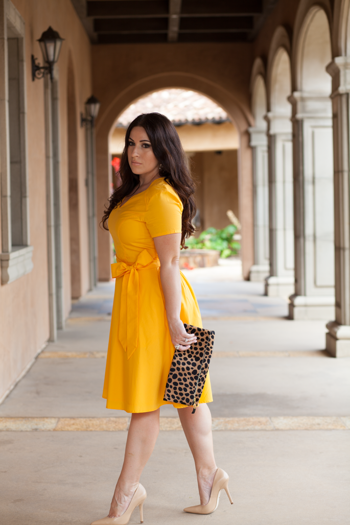 yellow custom eshakti dress, leopard clare vivier clutch, nude pumps