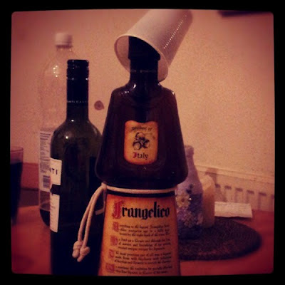 Frangelico in the shape of a monk with a hat