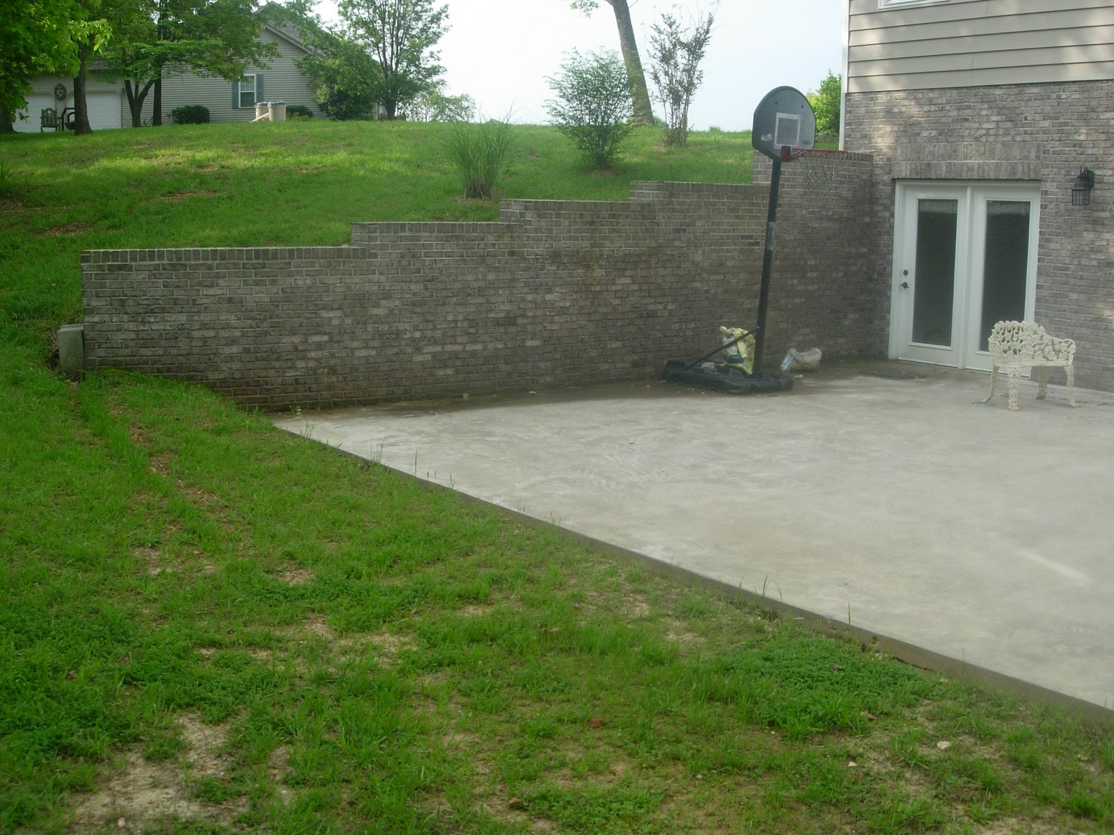 The johnston 39 s house before and after for House foundation on slope