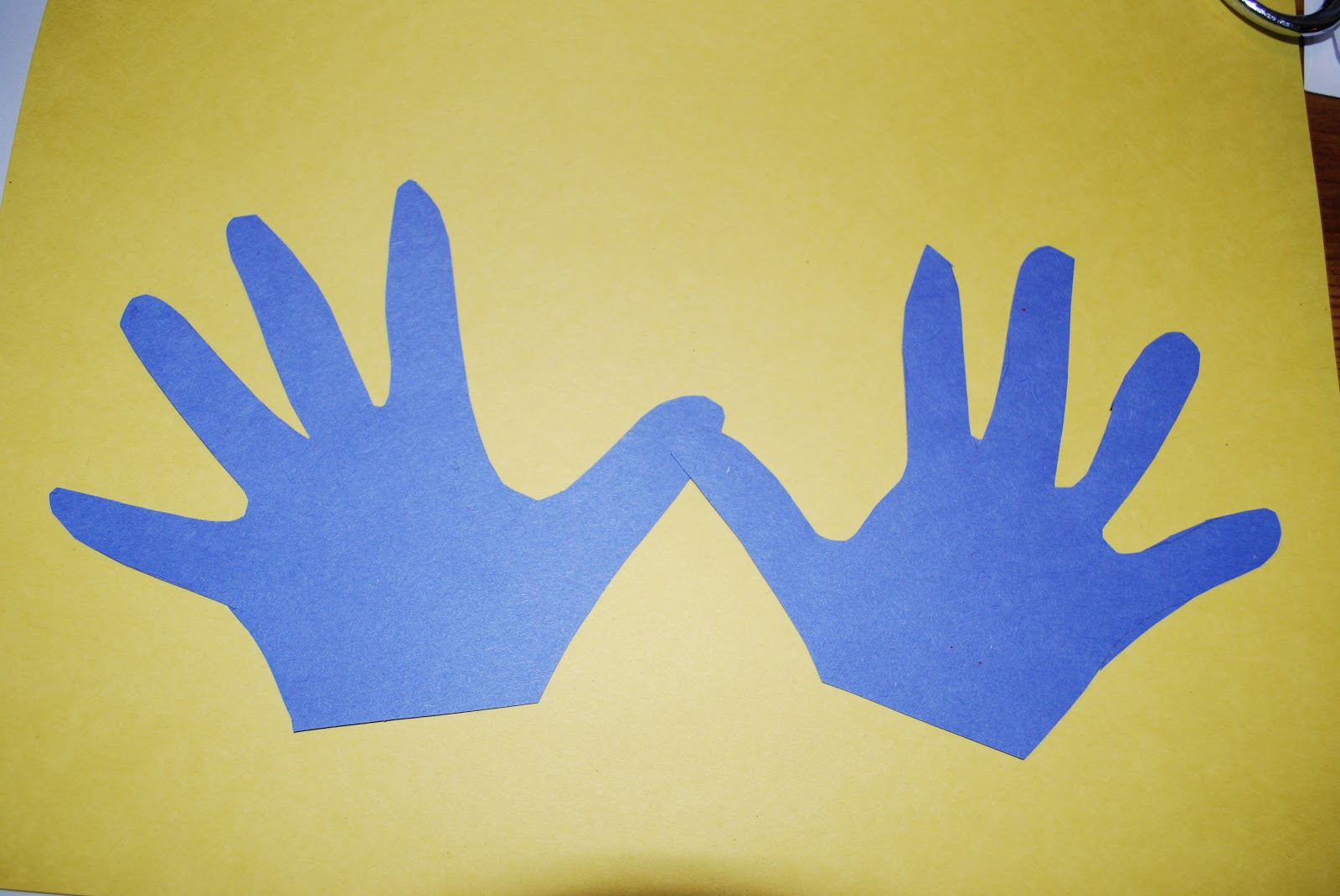 Uncategorized Handprint Menorah crafty mimzy handprint menorah glue hands with the thumbs overlapping punch out nine flames hole depending on size of hand prints you may want to cut the