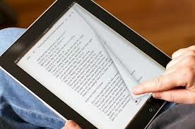 a person reading on an iPad