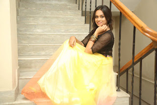 Geetha Bhagat in Stunning Transparent Net Top and Yellow Skirt At Kadile Bommala Katha Movie Audio Launch