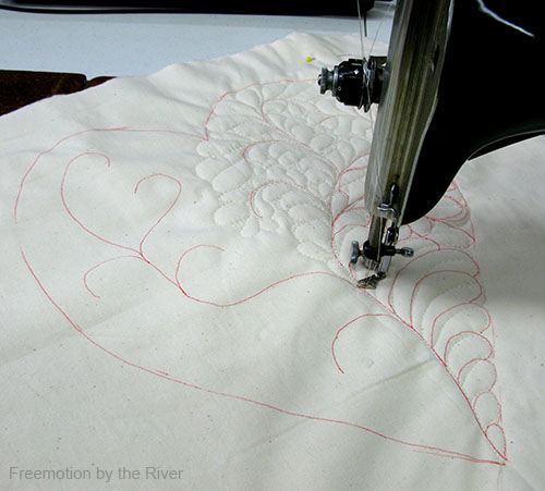 Feather quilting the heart