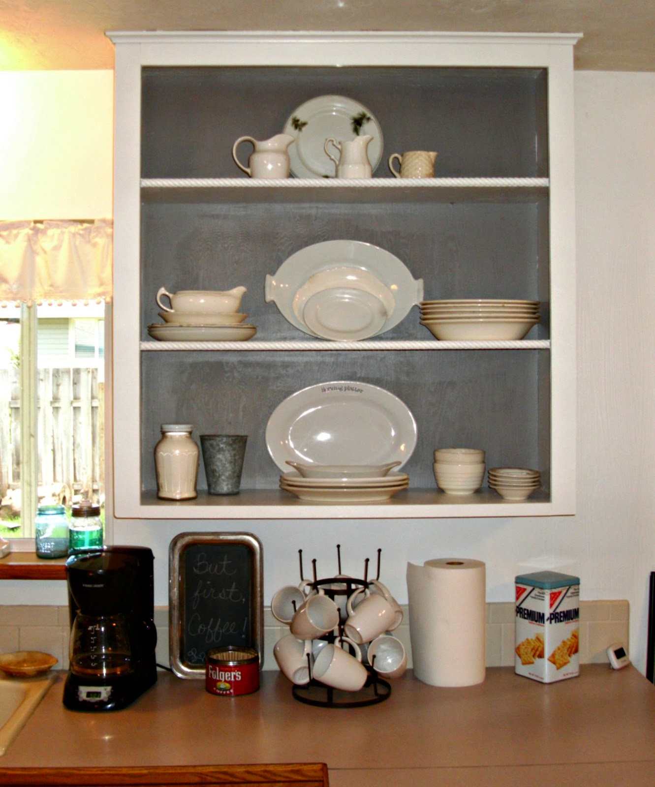 Diy open shelving in the kitchen little vintage cottage for Caulking around kitchen cabinets