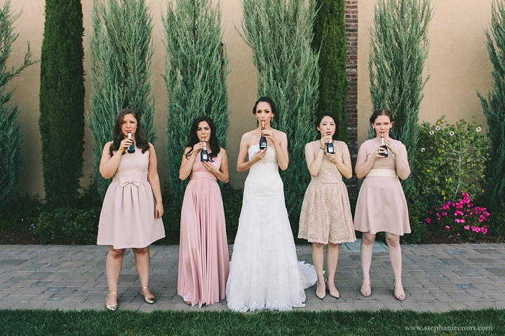 """""""bridesmaids with champagne at palm event center wedding"""""""