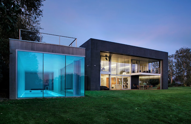 Photo of safest house and its pool house at sunset