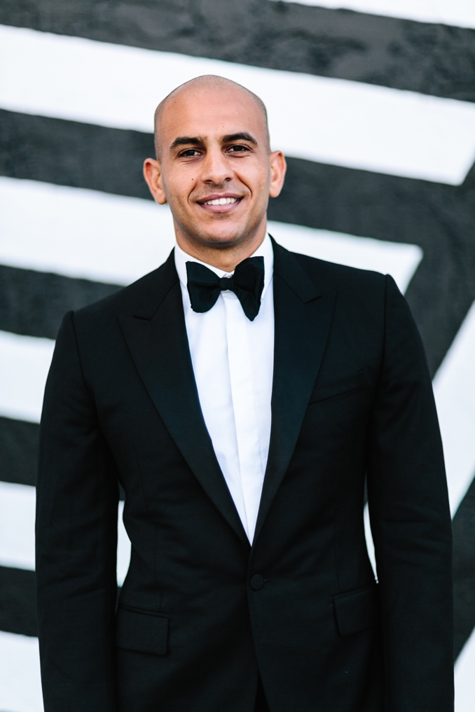 portrait of the Handsome groom wearing a Lanvin tuxedo and bowtie