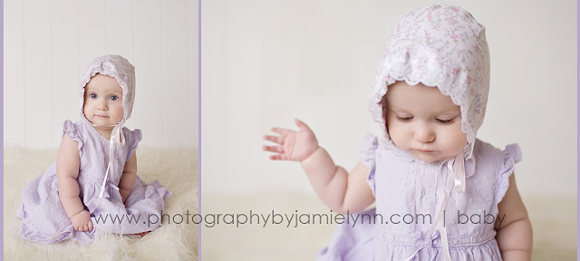Infant baby girl sitting up wearing purple dress and bonnet
