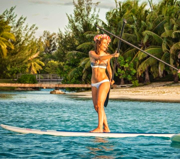 Maria Menounos showed off her luxurious trip by playing a paddle boarding with a female friend on the tropical island in Bora Bora on Monday, June 23, 2014.