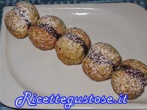http://www.ricettegustose.it/Biscotti_1_html/Baci_di_dama_ai_pistacchi.html