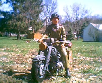 WWII German soldier and BMW motorcycle