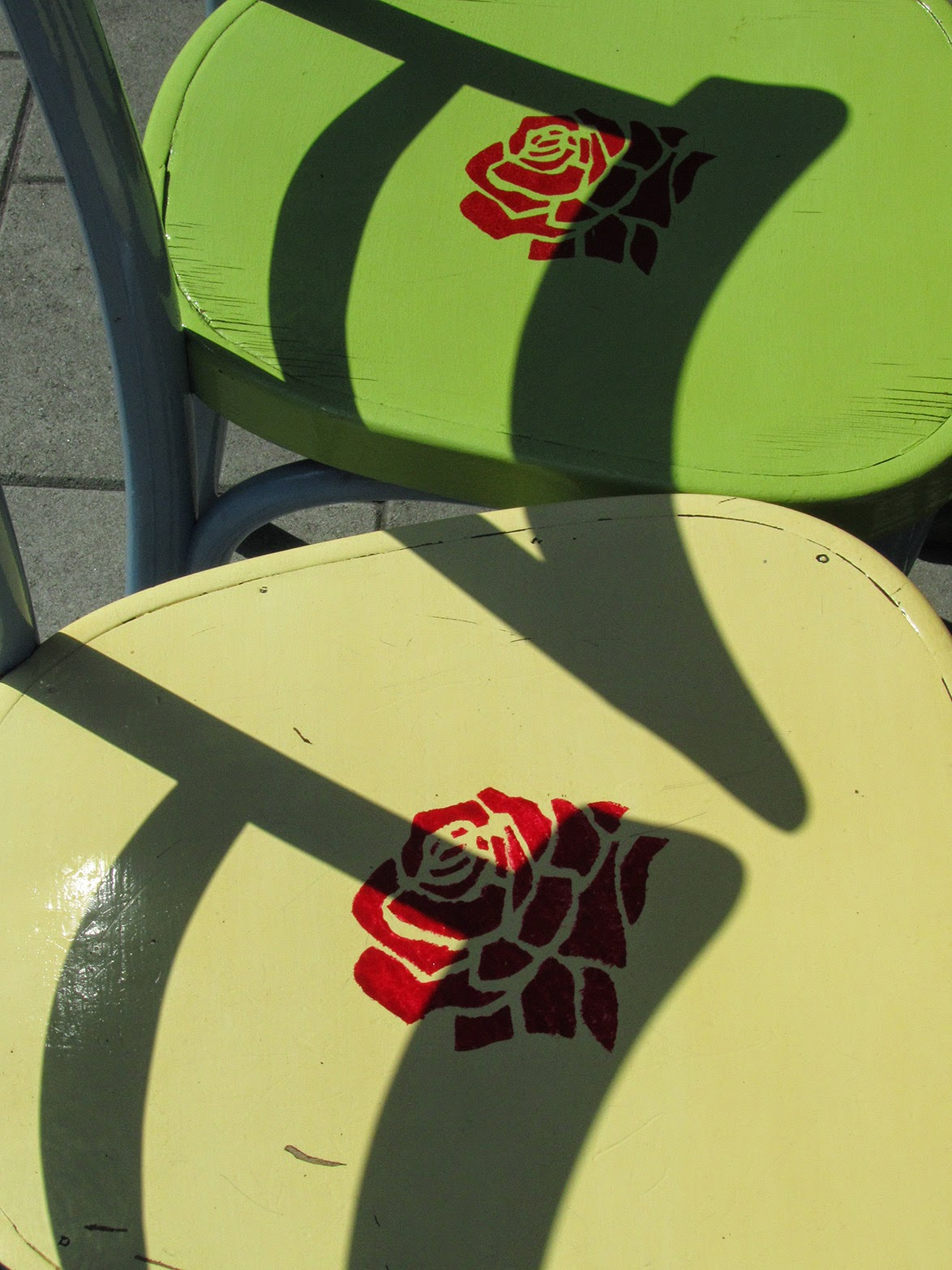 green chairs with red roses