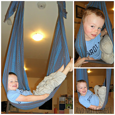 J showing how he swings in the DIY woven wrap swing from And Next Comes L