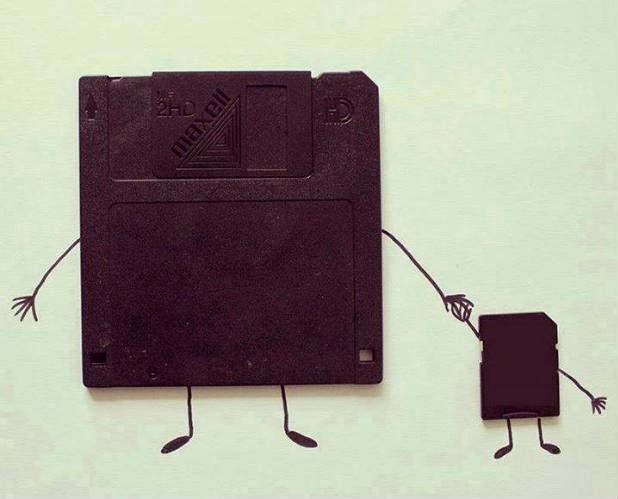 Funny storage technology, Father Floppy disc and Son memory card comparison, Funny pics, Funny technology pics, Latest technology vs old technology comparison, Magnetic floppy disc and small memory card appearance same, computer technology generation gap, funny memory card, funny storage card, funny pen drive