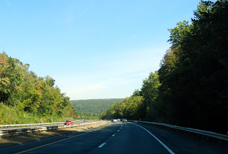 Views while driving on Interstate 90 in Massachusetts in the fall