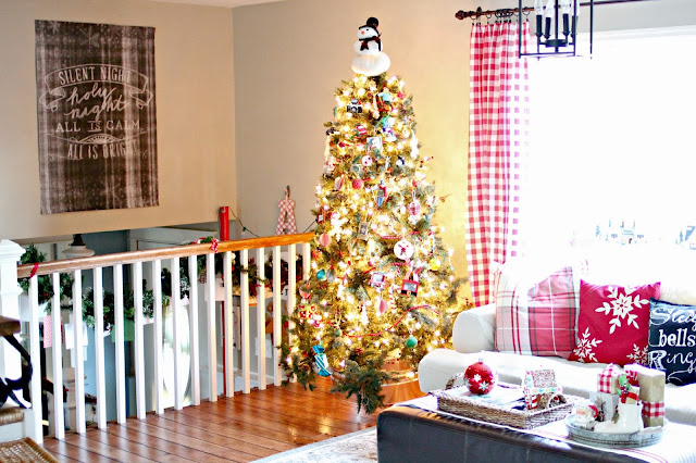 Red gingham drapes made from tablecloths and Pottery Barn plaid throw pillows at Christmas-www.goldenboysandme.com
