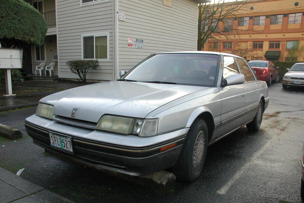 Old Parked Cars 1987 Sterling 825 Sl