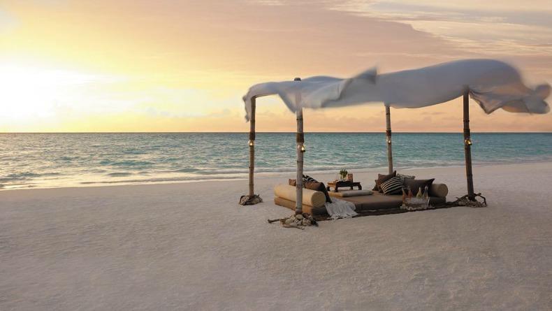 Romantic coastal beach picnic set up