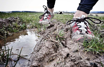 Running in Vivobarefoot Breatho Trails on a cross country, muddy run