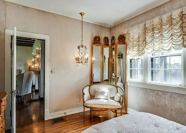 Ok, Those Ruched Curtains, That Brocade Wallpaper, MORE CHANDELIERS, And A  Quad Fold Baroque Mirror In Front Of A Dainty Little Settee.