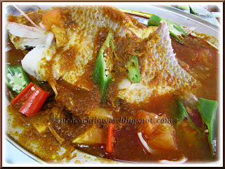 Steamed fish in assam sauce
