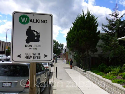 New but temporary signs encourage walking and cycling in Port Credit.
