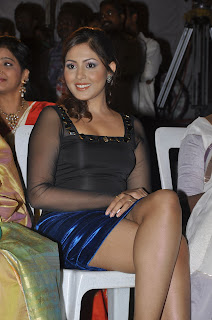 Madhu shalini in transparent black top and velvet short spicy pics