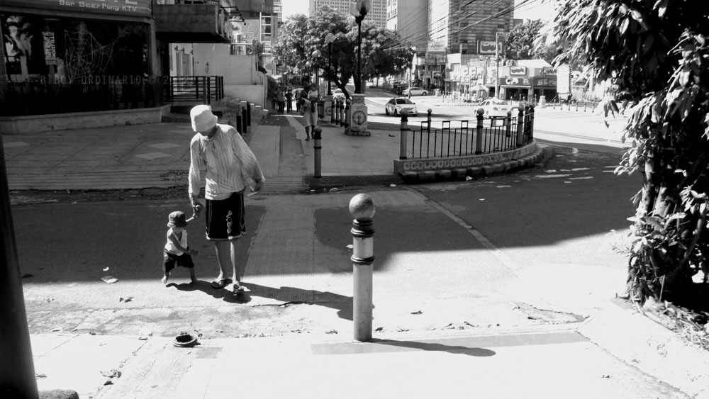 Father carrying son, Street Photography