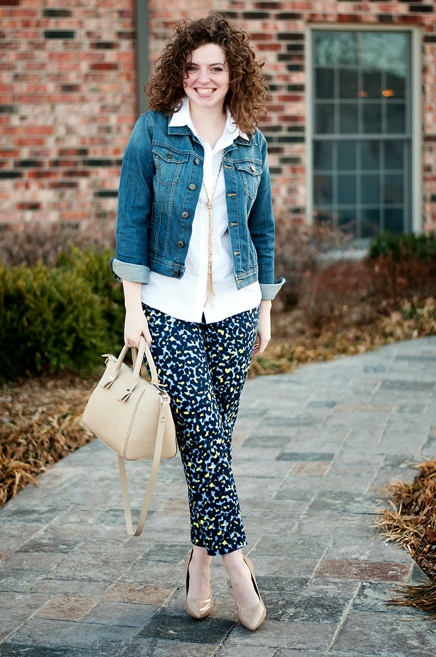 Denim jacket with animal print pants