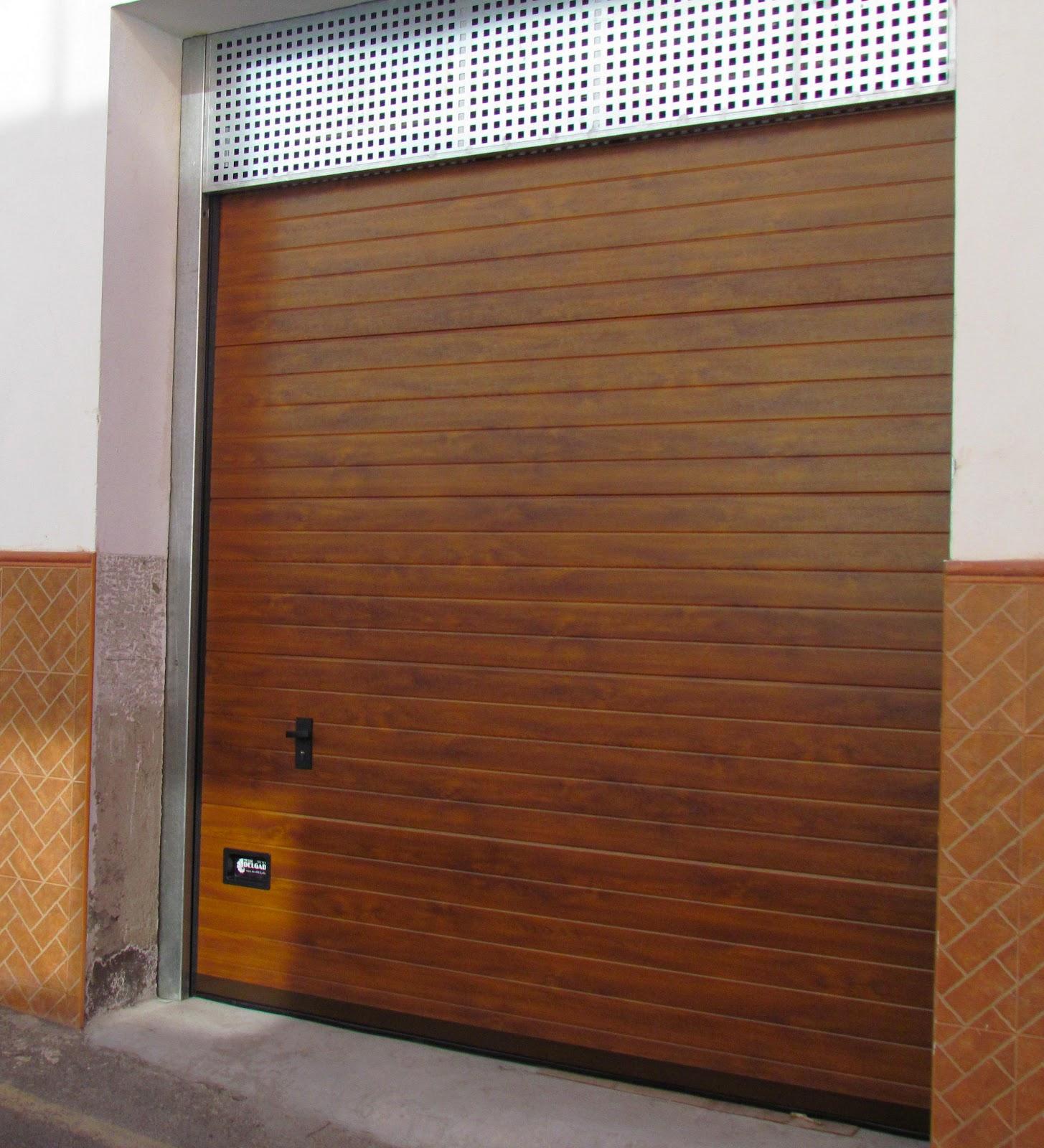 Acero inoxidable tenerife puertas garaje tipo seccional - Puertas de garaje de madera ...