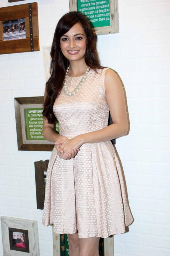 Dia Mirza in white short dress - Dia Mirza Launces the Body Shop Coconut Hair Oil