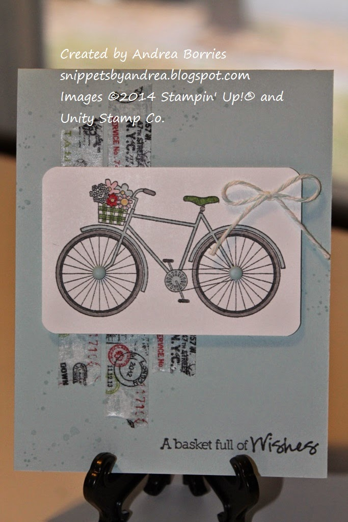 Birthday card with light blue card base, three vertical strips of travel-themed washi tape and a stamped bicycle as the focal image.